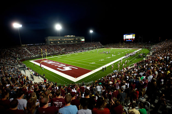 Night view of Saluki Stadium with fans at their al