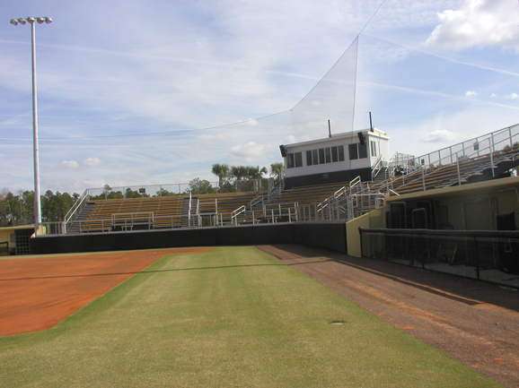 Outdoor bleacher seating and press box at the Univ